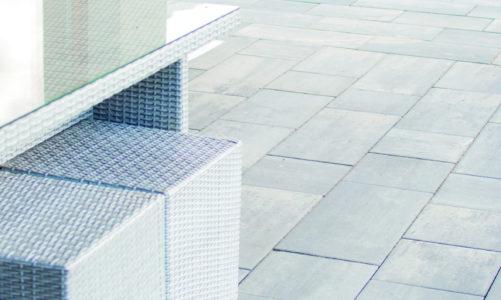 Minimalistyczna kostka brukowa, proste – geometryczne kształty, stonowana kolorystyka nawierzchni, kostka bez fazy